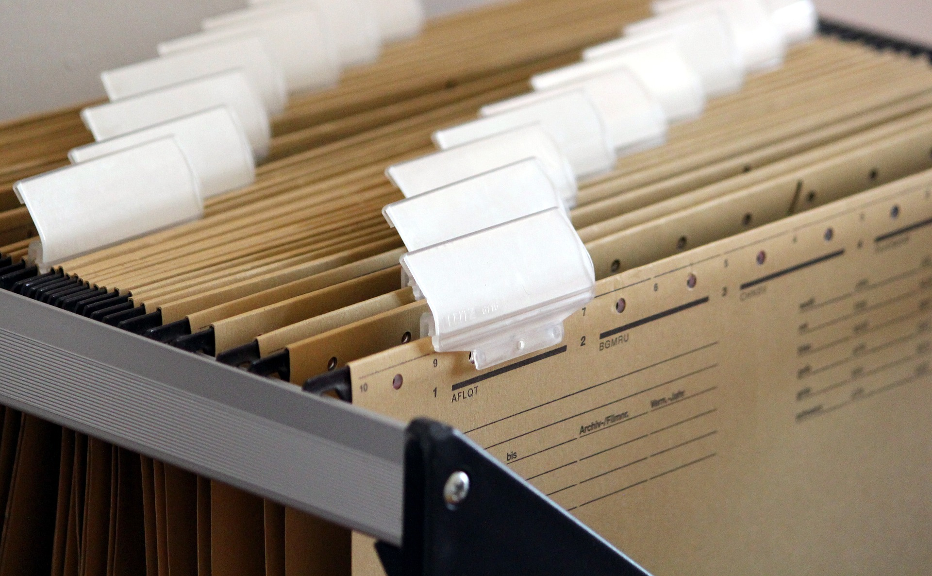 File drawer with brown hanging files and white tabs