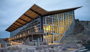 The George S. Eccles Dinosaur Park is a large glass building built into the hillside.