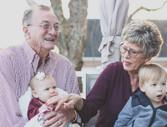 Picture of Grandparents holding their grandchildren