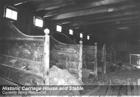 Horse stalls in the stable/carriage house before restoration