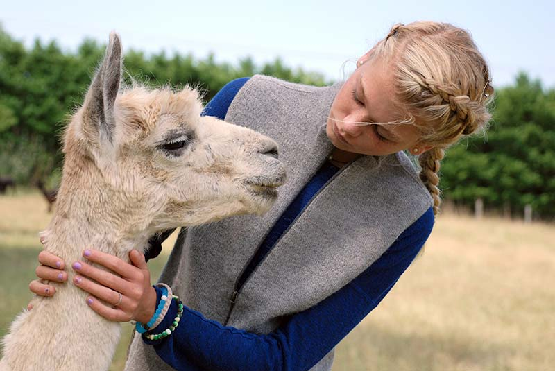 Girl modeling women's alpaca vest in silver grey