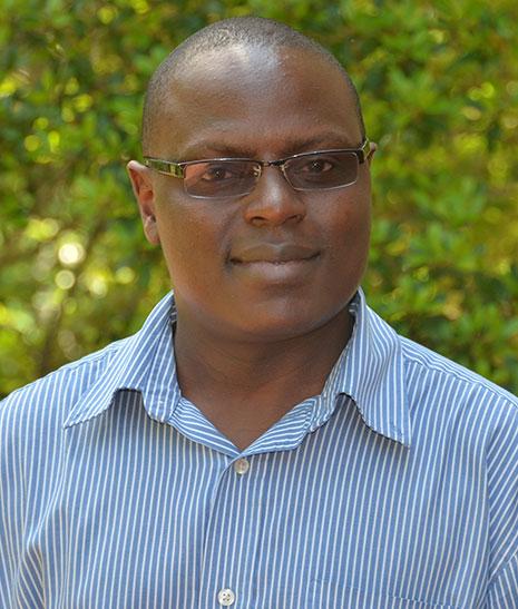 Dr. Dick Kawooya