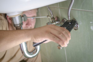Plumber using a wrench