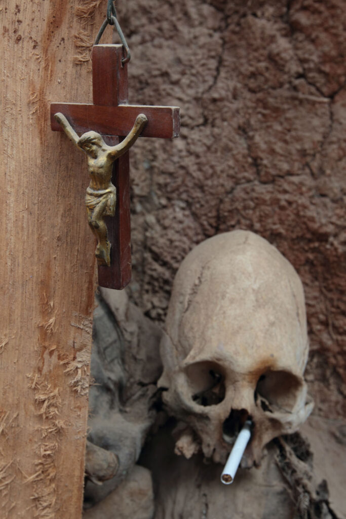 Altar with human skeletons and crucifix at the home of in Tarma, Peru.  Amazon Express expedition in Tarma, Peru August 17, 2012.    Photo by Erich Schlegel