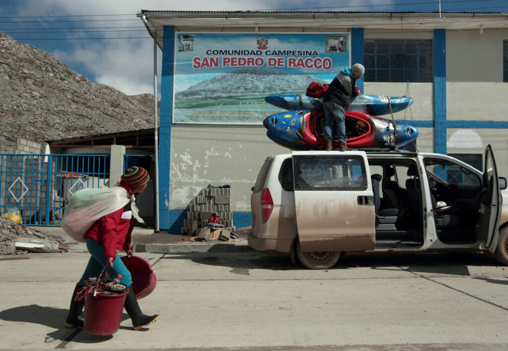 Amazon Express white water team member Rafael Ortiz (Mexico) ties down kayaks to the top of the van after an unscheduled overnight stop in San Pedro de Racco's city hall.  Amazon Express expedition in San Pedro de Racco, Peru August 20, 2012.    Photo by Erich Schlegel