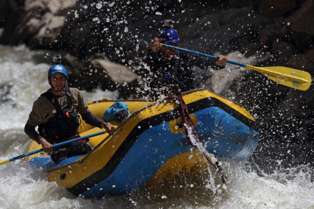 Amazon Express white water team member Juan Antonio de Ugarte (Peru), left, and expedition leader West Hansen (USA) paddle the white water raft through rapids on the Rio Mantaro.  Amazon Express expedition at Lago Agococha near Alpamarca, Peru August 17, 2012.    Photo by Erich Schlegel