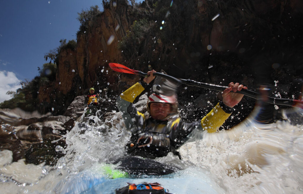 "Amazon Express white water team member Tino Specht (USA) plunges into the Rio Mantaro after portaging the Class V ""Tiger's Tooth"" rapid.  Amazon Express expedition in Peru August 24, 2012.    Photo by Erich Schlegel"