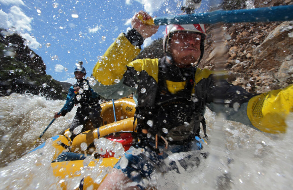 Amazon Express white water team members Tino Specht (USA), right, and Juan Antonio de Ugarte (Peru) drive their raft through rapids in the Rio Mantaro.   Amazon Express expedition in Peru August 24, 2012.    Photo by Erich Schlegel