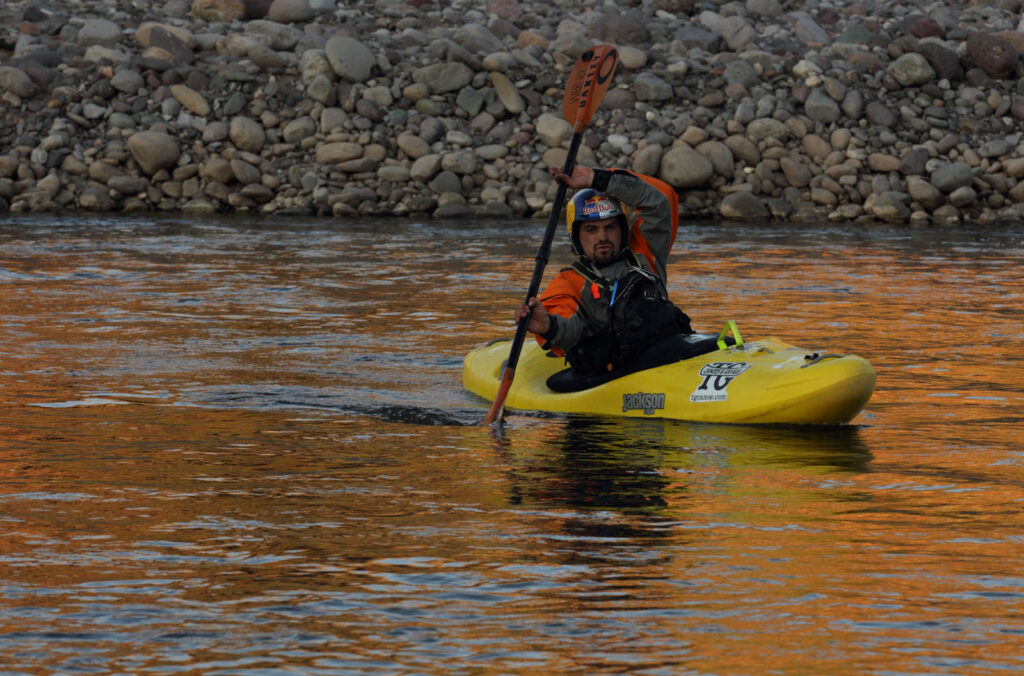 Amazon Express white water team member Rafael Ortiz (Mexico) warms up in the Rio Huarpa at the confluence of the Rio Mantaro where the team was to paddle 60-miles unsupported.  Amazon Express expedition in Peru August 28, 2012.    Photo by Erich Schlegel