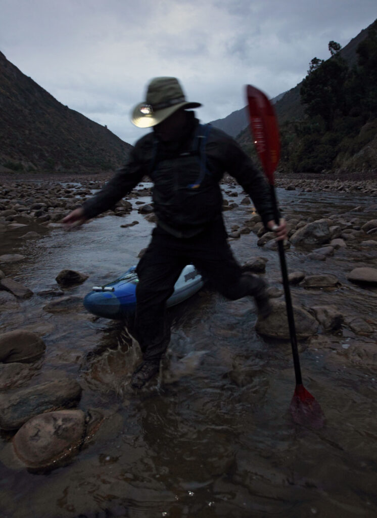 Amazon Express expedition leader West Hansen drags his kayak at dusk while negotiating the Rio Mantaro below Tablachaca Dam. The water is very low in this section of river during Peru's dry season. Water is also low due to the diversion of much of the Rio Mantaro through a tunnel for use in ElectroPeru's largest hydroelectric project downriver.  Amazon Express expedition in Peru September 13, 2012.    Photo by Erich Schlegel
