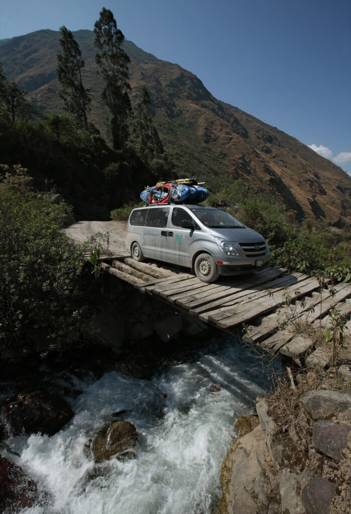 Amazon Express expedition support van driver Jeff Wueste drives over a questionable bridge en route to the Chiquia Bridge put in at the Rio Mantaro.  Amazon Express expedition in Peru September 18, 2012.    Photo by Erich Schlegel