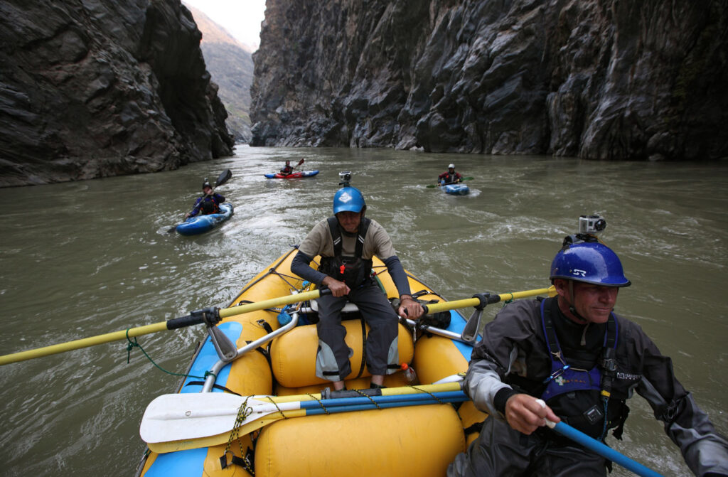 Amazon Express raft guide Juan Antonio de Ugarte of Cuzco, Peru runs expedition leader West Hansen through a box canyon during the last white water section of the Rio Mantaro. White water safety team paddles  behind the raft. From left, Santiago Iba–ez Corpancho, 30, Daniel Rondon Casos, 20, and Siabanel Loayza Carbajal, 22, all from Peru.  Amazon Express expedition in Peru September 18, 2012.    Photo by Erich Schlegel