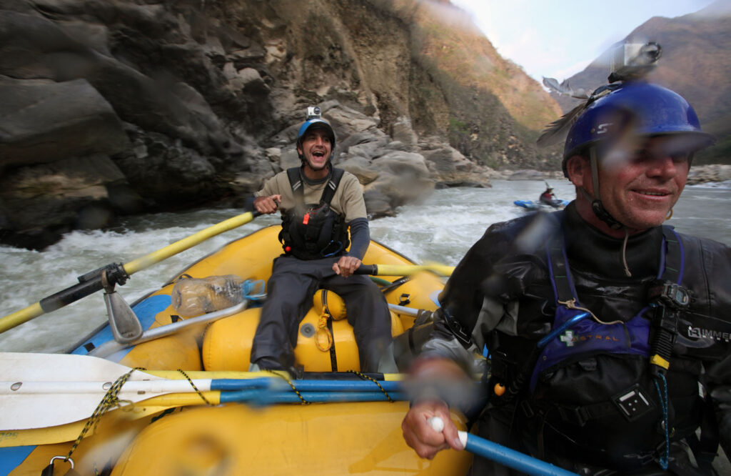 Amazon Express raft guide Juan Antonio de Ugarte of Cuzco, Peru runs expedition leader West Hansen through white water rapids in the lower Rio Mantaro.  Amazon Express expedition in Peru September 19, 2012.    Photo by Erich Schlegel