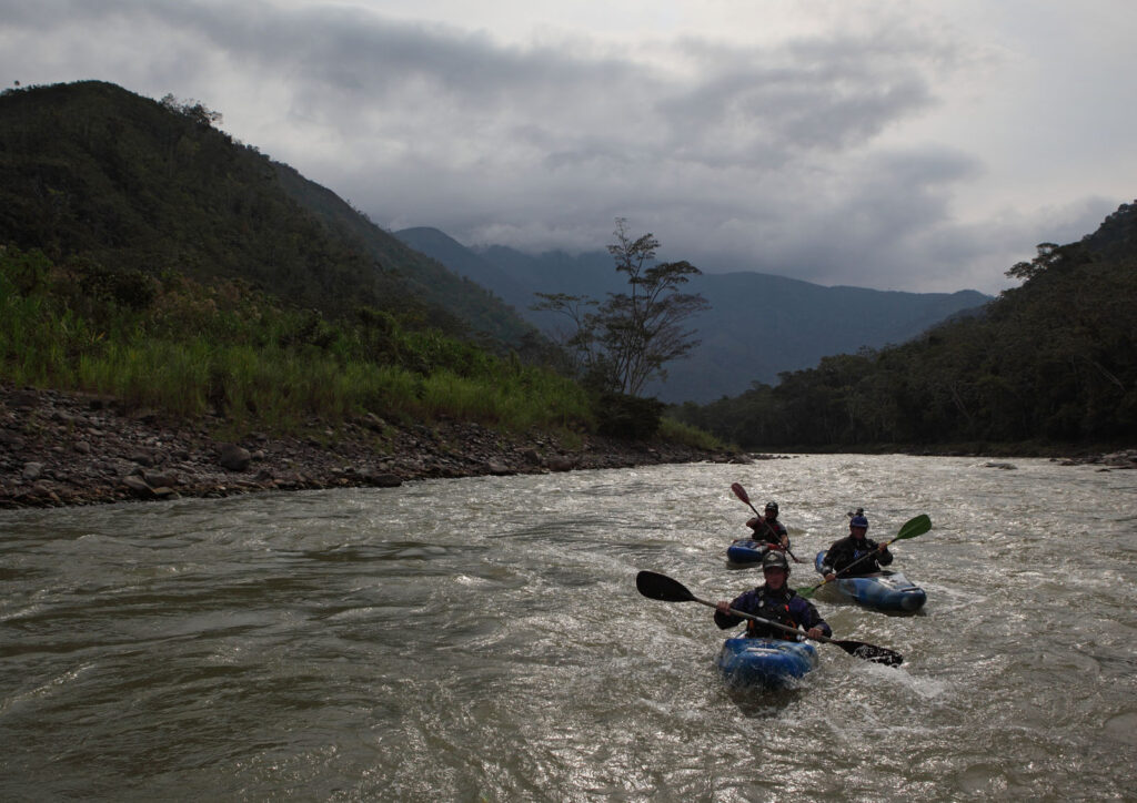Amazon Express white water kayakers from left, Daniel Rondon Casos, Santiago Iba–ez Corpancho, and expedition leader West Hansen coming out of the mountains and into the jungle on the lower Rio Mantaro.  Amazon Express expedition in Peru September 22, 2012.    Photo by Erich Schlegel