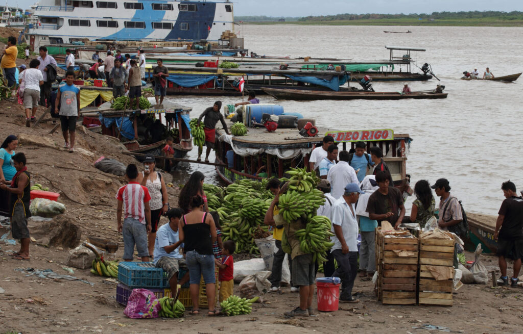 Workers unload banana stalks from transport boats at the main port in Pucallpa, Peru.   Amazon Express expedition in Peru October 7, 2012.   Photo by Erich Schlegel