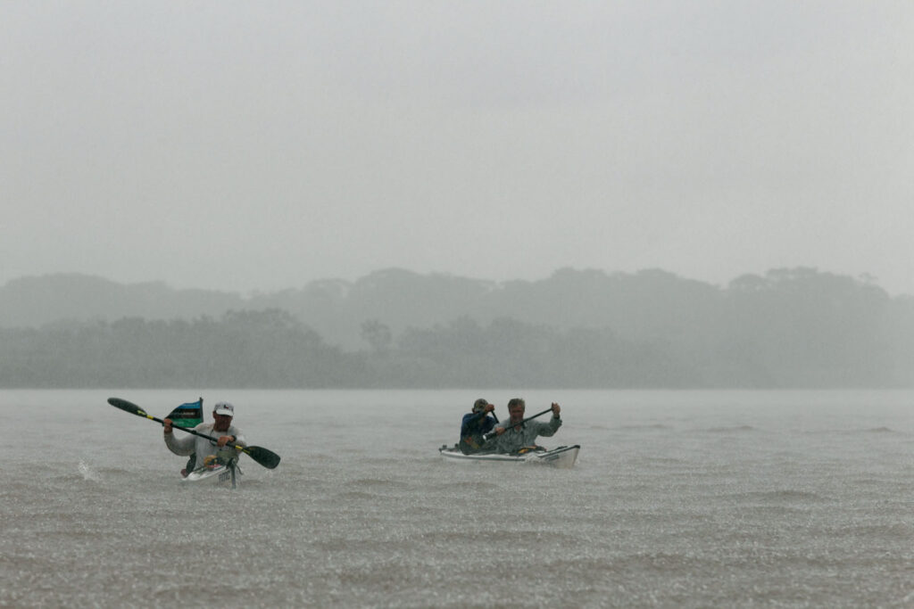 Amazon Express expedition leader West Hansen, left,  paddles with Jason Jones and John Maika during a heavy rainstorm on the Ucayali River as the team approaches Iquitos, Peru.   Amazon Express expedition in Peru October 17, 2012.   Photo by Erich Schlegel