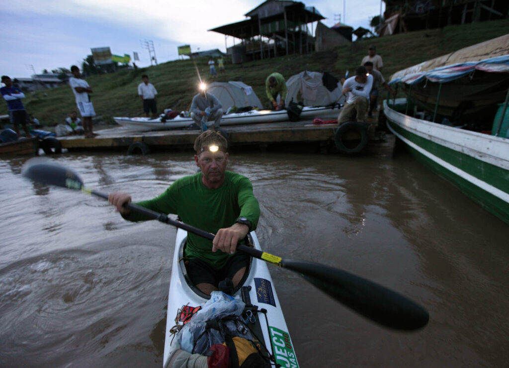 Amazon Express expedition leader West Hansen paddles away from the team's campsite on a raft dock in San Pablo de Loreto on the Amazon River in Peru. This was the team's final push through Peru to the Brazilian border.  Amazon Express expedition in Peru October 26, 2012.   Photo by Erich Schlegel