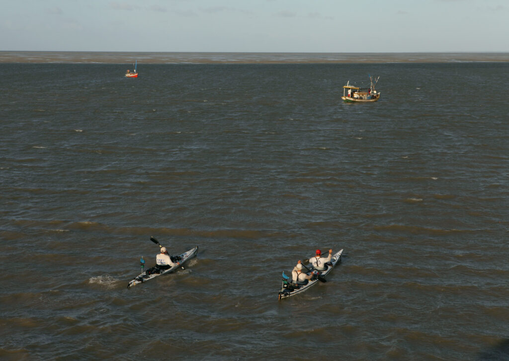Amazon Express expedition team members West Hansen, Jeff Wueste and Ian Rolls paddle toward the mouth of Baia de Marajo in Brazil, the end of their four month paddling expedition down the Amazon River toward the Atlantic Ocean.   Photo by Erich Schlegel