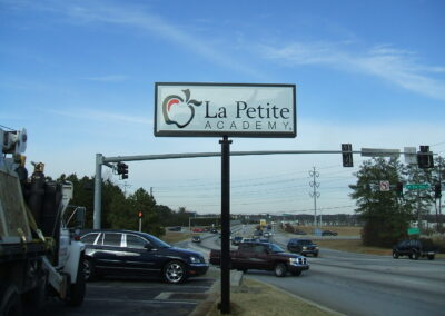 La Petite lighted pole sign