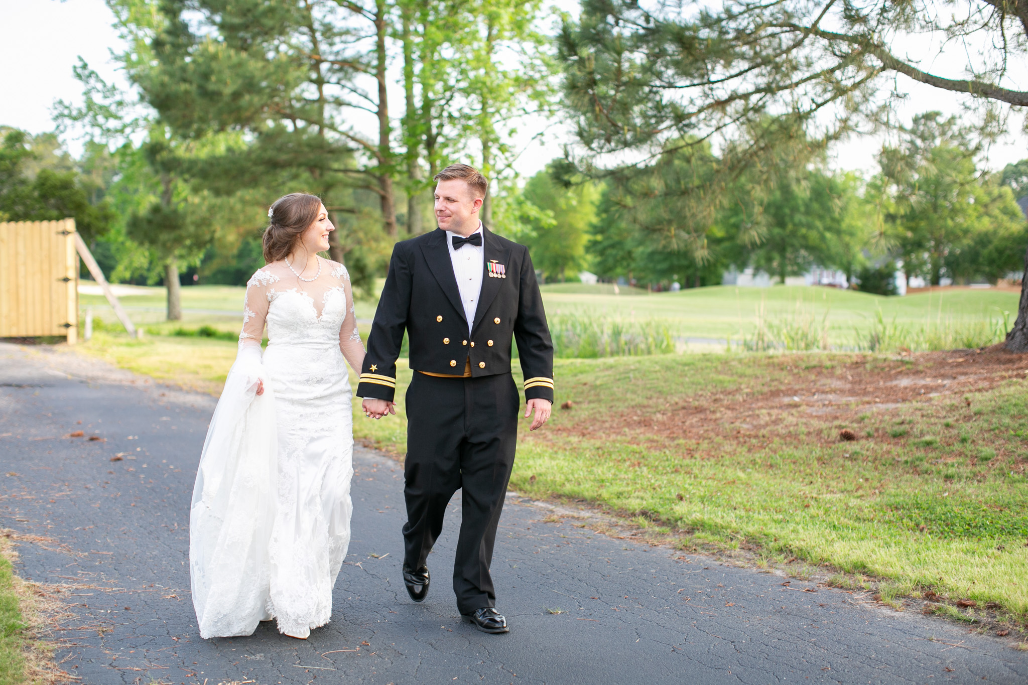 bride and grooming walking on golf course