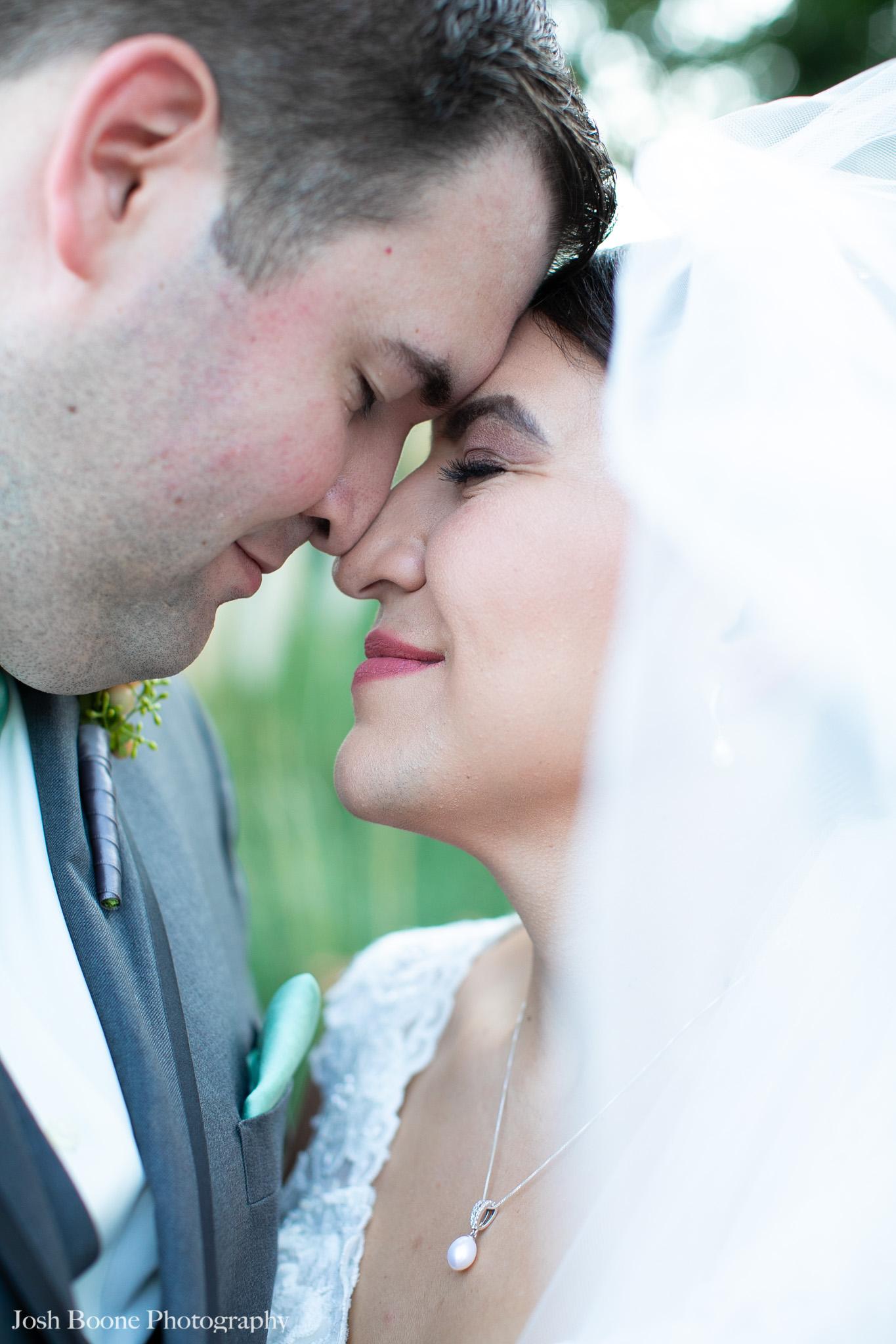 bride and groom close near garden at moca