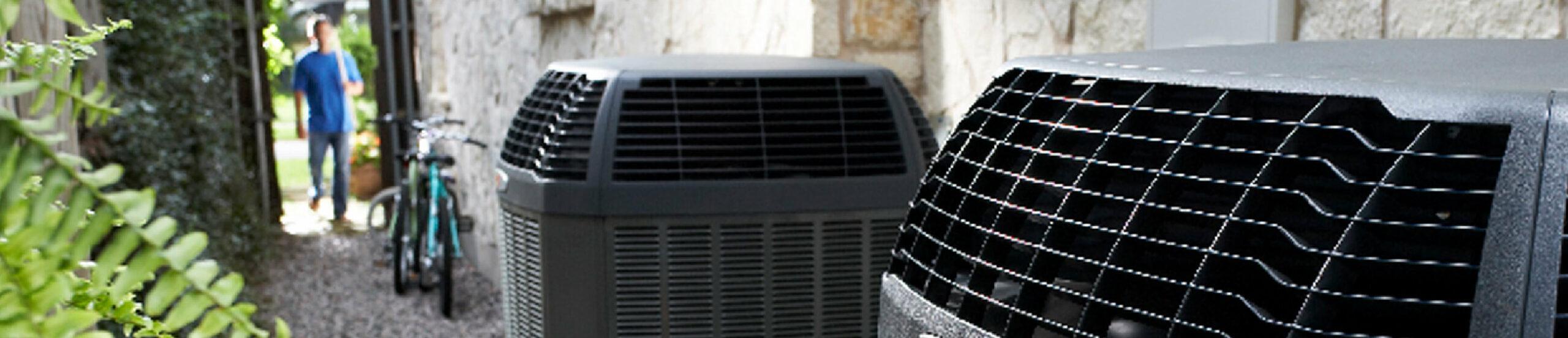 Close up of a Heat Pump unit next to a house