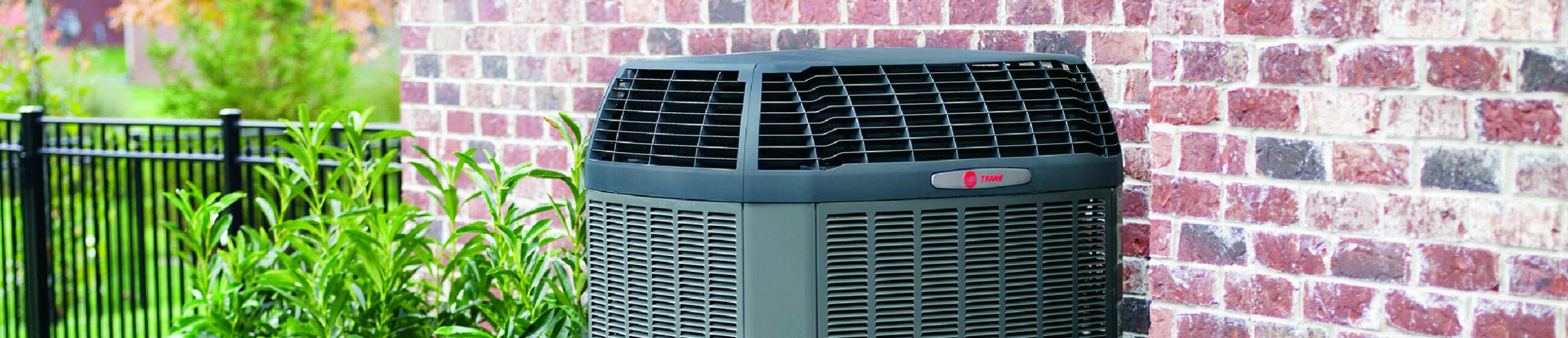 Close Up of an External Trane Heat Pump outside of a home