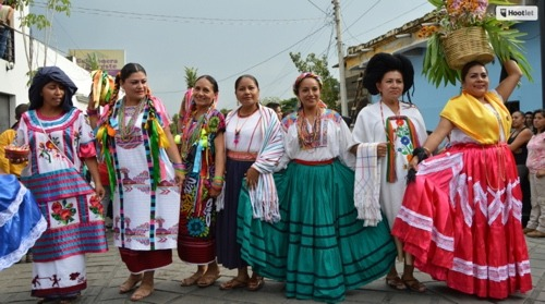 Oaxacan culture is continually celebrated. Teachers pos in traditional regional dress from some of Oaxaca's 8 regions.