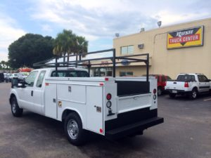 Action service body with ladder rack on the jobsite.