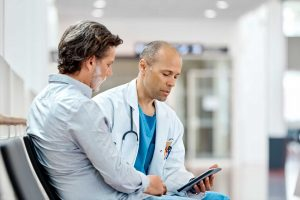 Doctor using sentactkiosk to capture patient feedback at the hospital