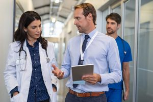 male and female doctor at the hospital discussing sentactrounding technology benefits