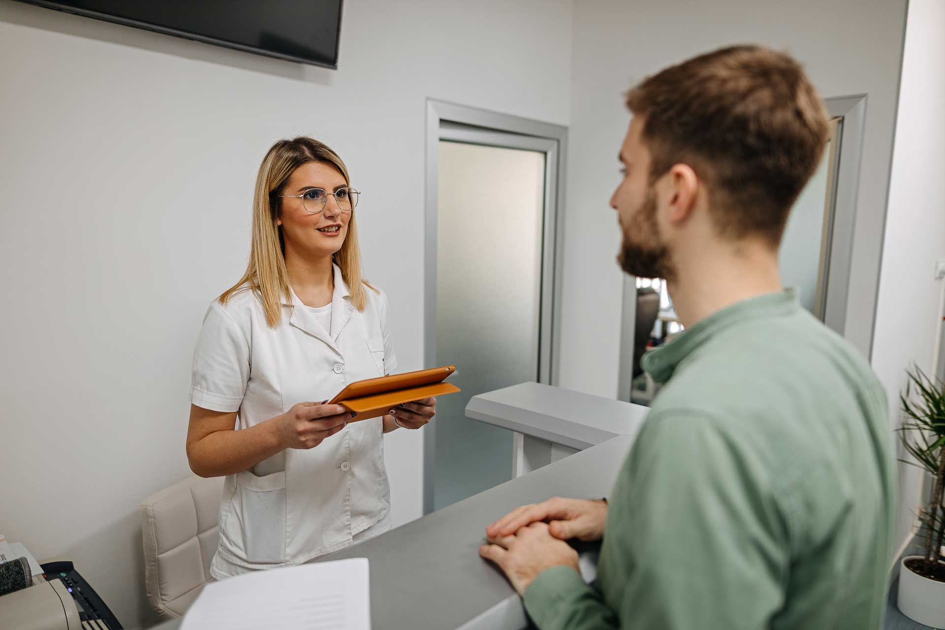 receptionist helping a patient using sentact technology