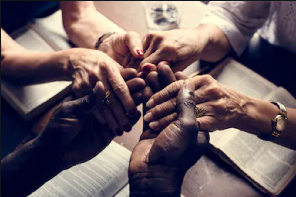diverse hands praying