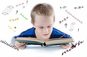 child studying math book
