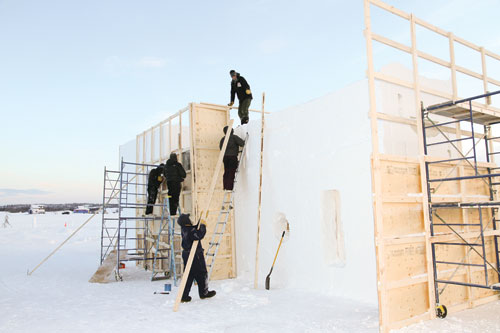A crew of dedicated festival workers set up frames for castle walls on a frosty Jan. 14. Work started at the crack of the new year. (Photo: Don Jaque)
