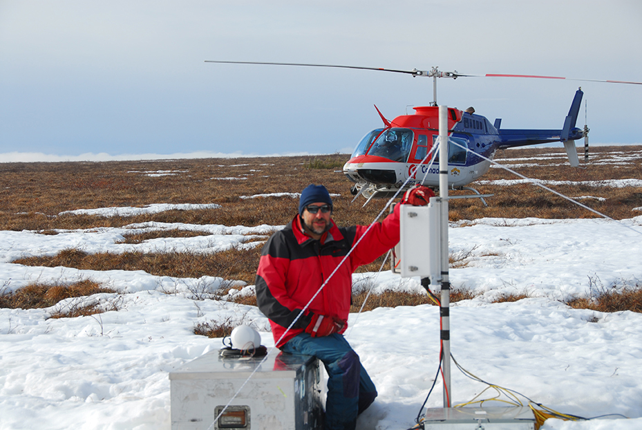 Philip Marsh sets up a data logger used to record hydrological and meteorological instruments during spring melt at Trail Valley Creek, a watershed 50 km north of Inuvik.