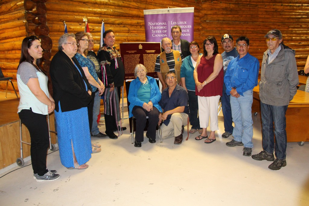 Descendants of Francois Beaulieu II gather around the plaque honouring him as a person of national historic significance.