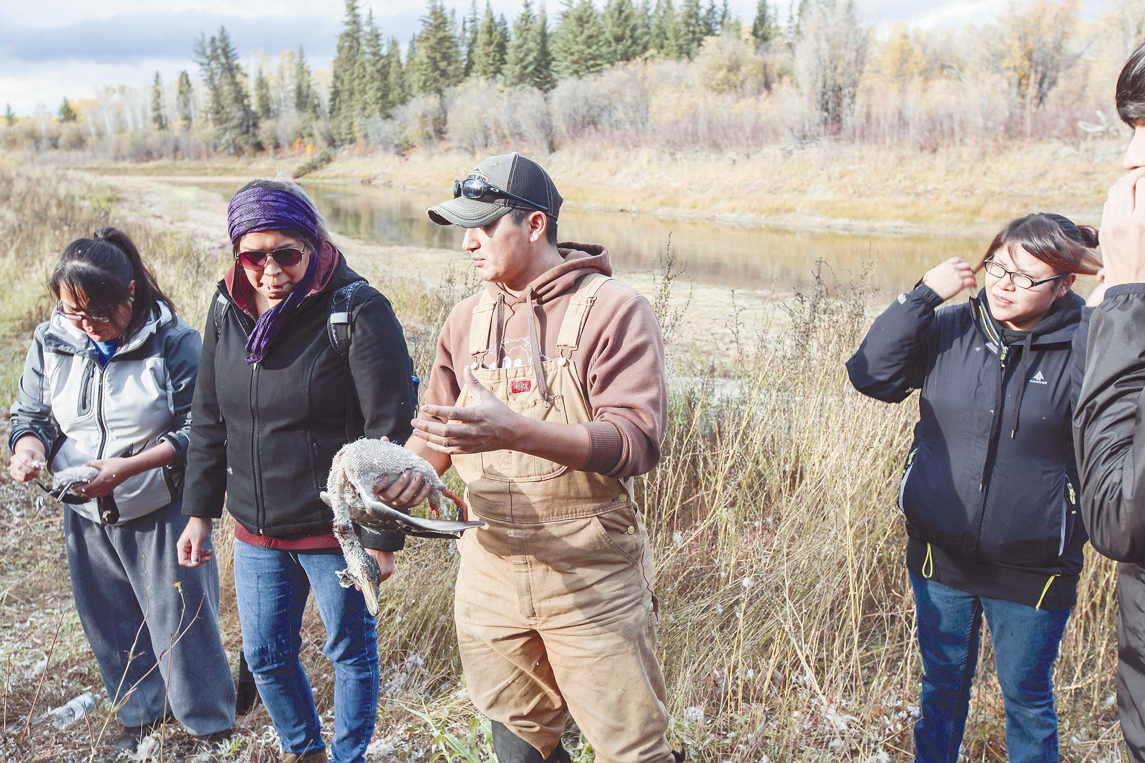 Robert Grandjambe from Fort Chipewyan shared his hunting and dressing knowledge with Aurora College students outside Fort Smith last week.