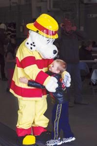 Isaiah Foss, 6, got a giant hug from YKFD mascot Sparky.