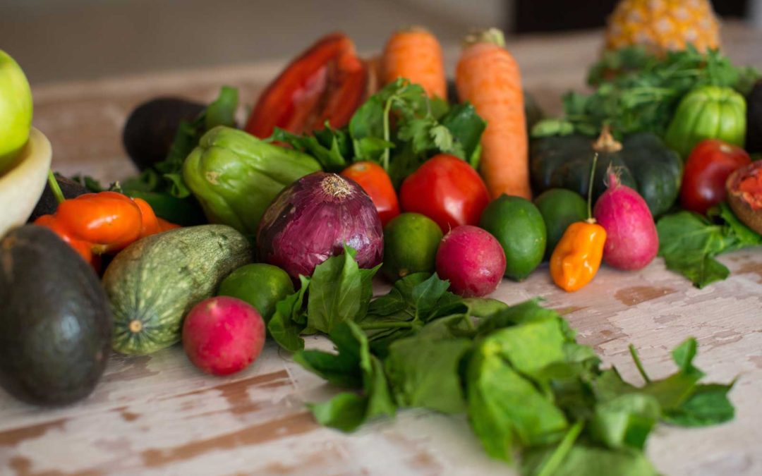 A bunch of fresh raw vegetables on a table