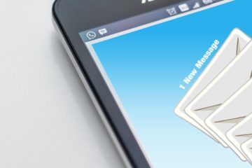 screen of a cell phone showing 1 new email message