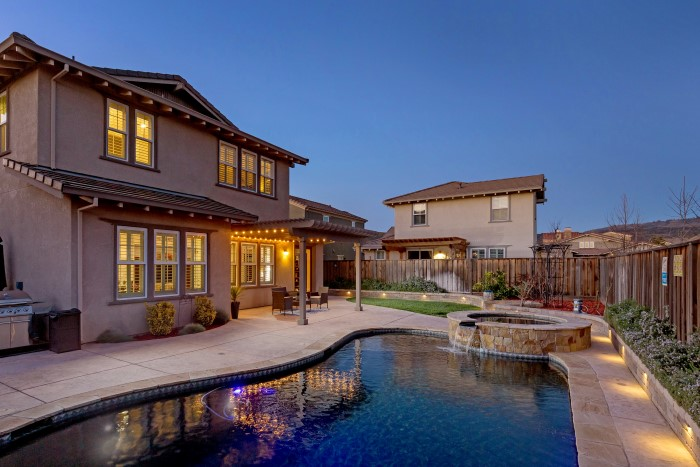 Photo of the pool and backyard at twilight at 1550 Bautista Way, Morgan Hill CA