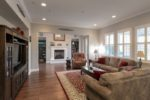 Great Room with hickory wood floors, plantation shutters, and recessed lights at 1550 Bautista Way, Morgan Hill