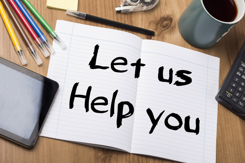 Let us Help you - Note Pad With Text On Wooden Table - with office  tools