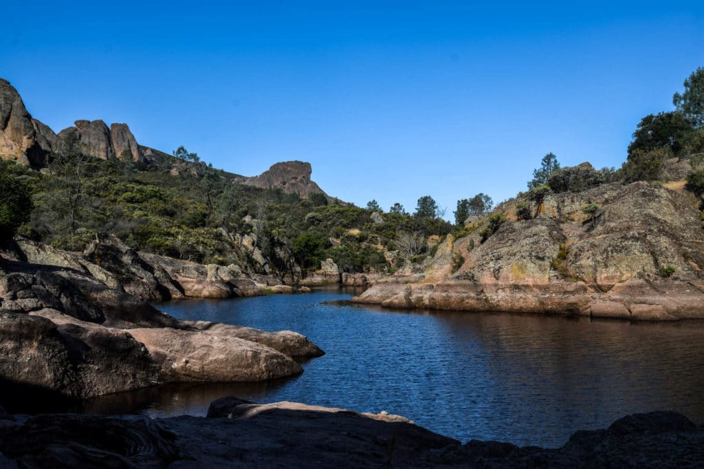 A picture of a lake surrounded by rocky outcropping in Pinnacles National Park