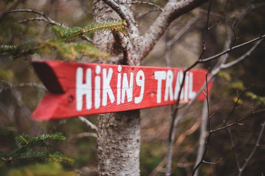 Red sign that says Hiking Trail