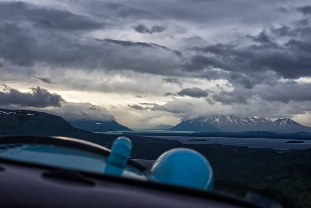The view out the window of a plane as it flys over Katmai National Park