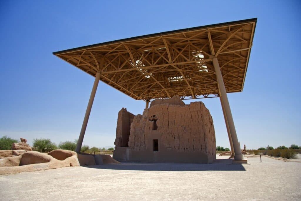 An Ancient Puebloan house protected by a modern shade structure.