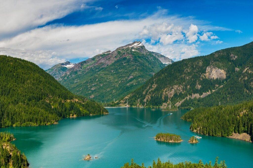 An aqua green lake in the mountains