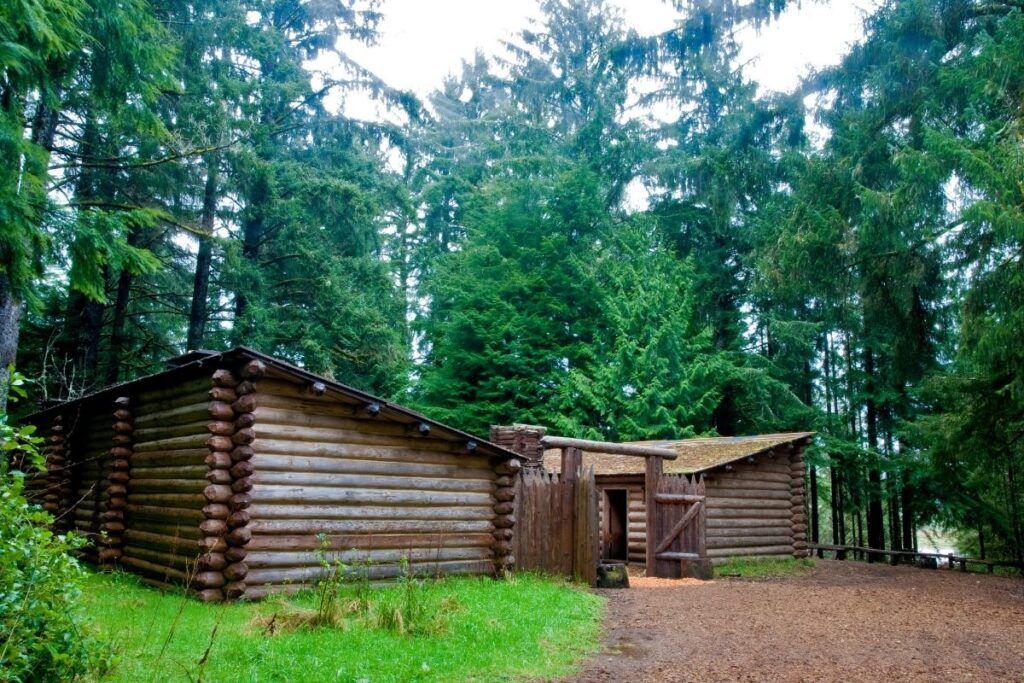 Two log cabin with a wood entrance gate